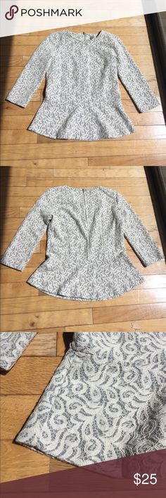 JCrew Lace Patterned Peplum 3/4 Sleeve Top This is a gently used Lace patterned 3/4 sleeve peplum top from JCrew. The color is a mix of grey and white. The material is 36% polyester, 29% cotton, 19% viscose, 16% nylon. Size XXS J. Crew Tops
