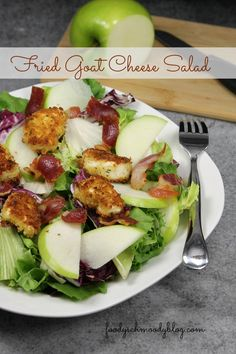 Fried Goat Cheese Salad - A salad of greens topped w/ crunchy coated goat cheese, crispy pancetta and tart green apples