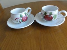 http://www.ebay.co.uk/itm/PORTMEIRION-POMONA-RARE-SET-OF-2-TEA-CUPS-amp-2-SAUCERS-ORIG-NO-BORDER-hoary-Apple-/161559735186?