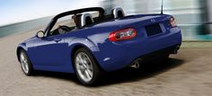 2012 Mazda MX-5 Miata.  Looks like a mighty fine sports car!