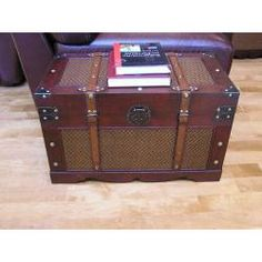 @Overstock - Wood finish: Antique dark red  Materials: White cedar wood with antique hardware  Indoor use  http://www.overstock.com/Home-Garden/Cambridge-Medium-Wood-Trunk-and-Wooden-Treasure-Chest/6311257/product.html?CID=214117 $98.99
