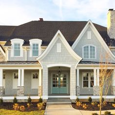 This is my dream home, even has a mint door. *swoon* (stonecroft homes)