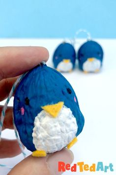 Red Ted Art's Walnut Penguin Ornaments! Learn how to make these adorable Walnut Ornaments! We love Penguin Crafts for Christmas and Winter decor. Soooo cute! Leanr how today!