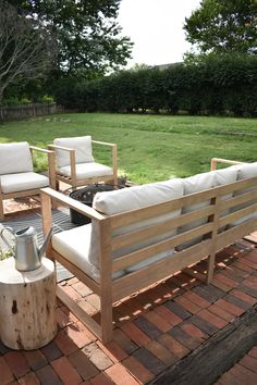 DIY Modern Outdoor Sofa - House On Longwood Lane - modern outdoor patio chair with neutral cushions and grey geometric rug Resin Patio Furniture, Diy Furniture Couch, Diy Outdoor Furniture, Garden Furniture, Furniture Ideas, Furniture Layout, Furniture Design, Furniture Makeover, Painted Furniture