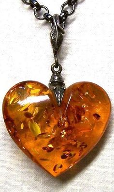 I'd like an orange and gold pendant for your necklace to offset your orange flowers in the bouquet and hair.