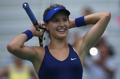 Eugenie Bouchard Photos: Dongfeng Motor Wuhan Open: Day 5. Eugenie Bouchard of Canada celebrates after winning her match against Alize Cornet of France on day five of 2014 Dongfeng Motor Wuhan Open at Optics Valley International Tennis Center on September 25, 2014 in Wuhan, China.