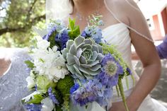 Periwinkle wedding in Malibu. Bridal bouquet with succulents, scabiosa, freesia, delphinium, roses, stock, and hanging amaranthus.