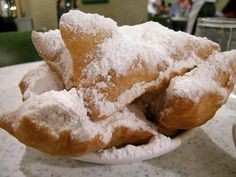 Beignets Recipe served at Port Orleans French Quarter Food Court in Port Orleans French Quarter Resort at Disney World - A pastry made from deep-fried dough, much like a doughnut, and sprinkled with confectioner's sugar, or frostings. Köstliche Desserts, Delicious Desserts, Dessert Recipes, Yummy Food, Donut Recipes, Copycat Recipes, Cake Recipes, Beignets, Scones