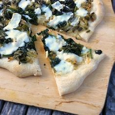 Green & White Summer Pizza – make this one on the grill with your favorite greens, garlic, onions and fresh mozzarella