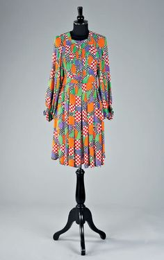 Jean Muir - Printed chiffon mini-dress, late 1960s, labelled Jean Muir and size 10, with pin-tucked and button-fronted yoke, low inset balloon sleeves, `Apples and Pears' print, bust approx 82-86cm, 32-34in. An identical gown was used on the front cover of `Vogue' 1972. Glenda Jackson wore a similar gown in the film `A Touch of Class' in 1972.