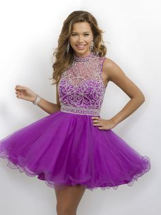 A tulle skirt dress and a heavily beaded high neckline along with an open back is just glamorous, and it's at Rsvp Prom and Pageant, your source for the Hottest Homecoming, Prom, and Pageant Dresses!