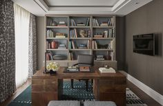 Study with desk and bookcase built-in drapery panels over sheers