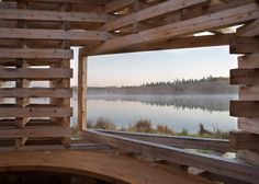 Young Projects creates fireplace hut for lakefront in Canada