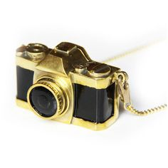 Gold Camera Necklace ($119) ❤ liked on Polyvore