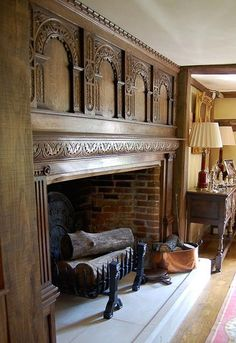 and century style oak panlled fireplace with highley decorative carved arches Home Fireplace, Fireplace Mantels, Interior And Exterior, Interior Design, Fire Surround, House Blinds, Oak Panels, Beautiful Interiors, Old Houses