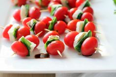 Appetizer version of Caprese Salad - took me about 10 minutes to make using 1 tub of tomatoes.  Make the skewers and put in fridge night before work potluck - put dressing on just before setting out.