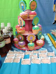 Finn's utensil holders and a tower of cupcakes
