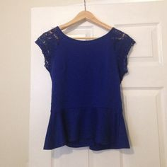 Royal blue peplum top with lace sleeves and back Royal blue peplum top with lace sleeves and back! Great to wear a bandeau under with jeans and boots or heels. Worn twice and in perfect condition. Will fit 4 or 6 Miami Tops Tunics