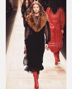 Gigi rocking the runway dressed in a black dress , faux fur shurg and high rise boots. #gigihadid #modelstyle #rightouttatherunway #getthelook #shopthestyle #bigstyler #ootd #currentlywearing #wearitloveit #todaysdetails #lookoftheday #mylook