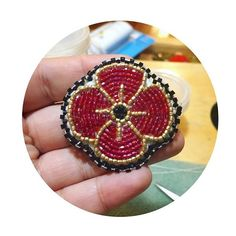 made by I just did the backing and edging 👍🏽 one of our poppies for the fundraiser! Remembrance Day Poppy, Poppy Pins, Poppy Pattern, Beadwork Designs, Native Beadwork, Beaded Brooch, Pearler Beads, Quilling, Fundraising