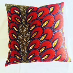 Brighten up your sofa with our Red and blue Ankara wax print Scatter Cushions. 100% cotton  Invisible zip 45cm x 45cm  Make a statement!
