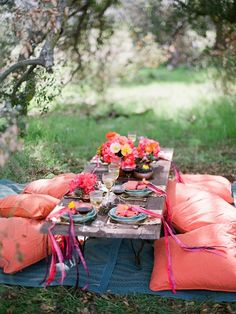 Outdoor dining with picnic blanket, low table and pillows for seats!