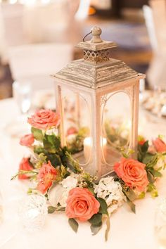 Wedding lantern centerpiece with coral roses| Floral design - PSJ Photography   #weddings #weddingflowers #centerpiece #weddingcenterpiece #weddingdecor #weddingdecorations #floral