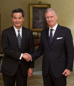 (L) Hong Kong's leader, Chief Executive Leung Chun-ying is welcomed by King Philippe of Belgium prior to their meeting on 15 May 2014, at the Royal Palace in Brussels.