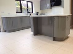 Custom painted gloss kitchen in a mid grey with white quartz.  Kitchens, Milton Keynes