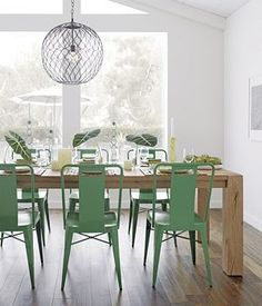 Inspiration for kitchen--green chairs, reclaimed wood table.