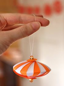DIY striped paper ornament. I'm going to do some red and white for the Christmas tree.