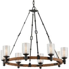 With its rope-wrapped ring frame and ribbed glass shades, this hand-forged pendant is the perfect finishing touch for a loft-chic or modern farmhouse look.