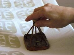 African batik. This method uses a stamp to apply the hot wax.