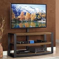 The Santa Fe 3-in-1 flat panel TV console is a smart combination of contemporary and rustic with warm ash grain finish and heavy iron frame featuring a semi distressed iron wash finish. Three ways to display TVs up to 65 Inch: use the rear column with built-in swivel mount, hang on the wall... more details available at https://furniture.bestselleroutlets.com/game-recreation-room-furniture/tv-media-furniture/television-stands-entertainment-centers/product-review-for-whalen-fur