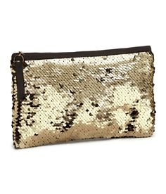 Add a dash of glam to your out-on-the-town ensemble with a gold sequin clutch. | Party in H&M