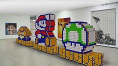 http://distractify.com/john-londergan/masterpieces-made-with-rubikcubes/