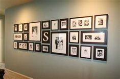 Family picture display for gray wall that I will have someday :-)looks so clean. Great for old family pix