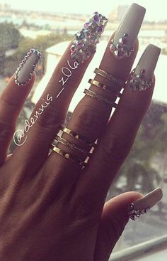 love the diamonds on her nails, and the rings on her fingers