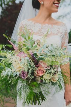 Incredible oversized wedding bouquet by Ideal Beau Flowers.  http://www.clairemorrisphotography.com/