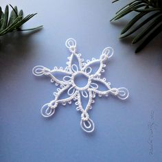Here's the pattern for this pointed snowflake with double picots. It's made using one shuttle and the ball thread .      Mock ring in ...