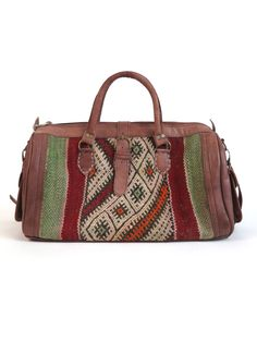 HANDMADE IN: Morocco LENGTH: 18'' HEIGHT: 9.5'' MATERIAL: Leather and vintage Kilim. DETAIL: Makes for a perfect weekend bag! Zipper closure. Two side pockets, detachable cross-body strap.