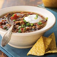 This recipe Mexican Black Bea Chili with homemade sausage calls for a mouth-watering blend of paprika, ancho chile powder, cumin and more.
