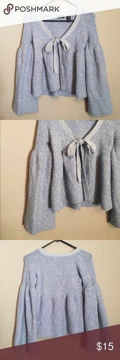 MODA International dramatic sleeve sweater •great condition •MODA International •light blue/periwinkle •dramatic bell sleeves •tie neck •open front sweater •VERY soft material •size small, fit is true to size Moda International Sweaters