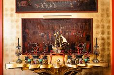Hutton Wilkinson ~ Seventeenth-century Venetian paintings hang above a console created by costume designer Don Loper in the 1940s. The 18th-century Chinese lacquer coral branches are from the collection of Elsie de Wolfe. 1