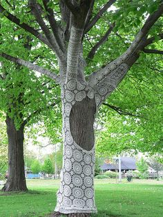 Tree with Lacebombing by Janet Morton