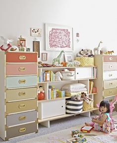 Oh I LOVED this idea from the moment I saw it! Joy Cho from Oh Joy! painted the drawers of (what would otherwise be very serious-looking) military chests in a variety of dusty pastels for her little girl's nursery.