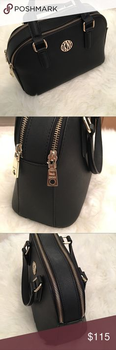 DKNY black %100 leather satchel bag w/gold hardwar No flaws, Excellent condition. Perfect bag for dressing up any outfit. Two separate compartments with DKNY printed interior. This bag has light gold hardware feet on bottom. Stylish design. DKNY Bags Satchels
