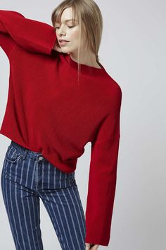 Give wardrobe staples a total makeover in this ribbed funnel neck top. This long sleeve top features on-trend fluted sleeves, with an all-over ribbed detailing and compact funnel neckline. Team it back with statement accessories for a day-to-night look. #Topshop