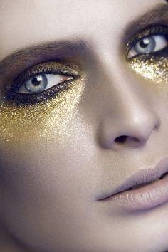 glitter eyes, dark purples, blues, reds, anger, aggression, power, demanding, direct, hard