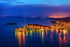 """Sparkling on the Blue Adriatic"" by Aleksandar Gospić. ""Night falls over Primošten town and the islands of Šibenik archipelago on the Croatian coast, in the distance are the lights of Šibenik city"""